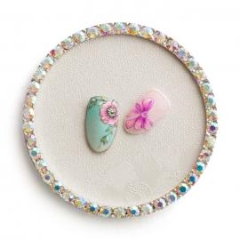 Expositor para tips decorados. Fondo con dibujo de flor y marco con brillantes multicolor